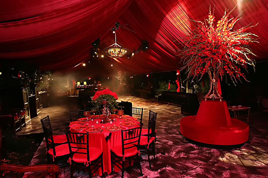 interior of tent draped entirely in red on a private estate, may not be copied