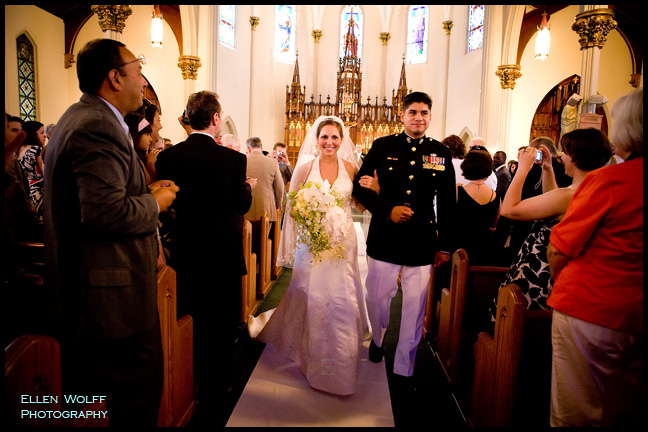 The bride and her  groom make their way up the aisle at St James Church in Manchester CT