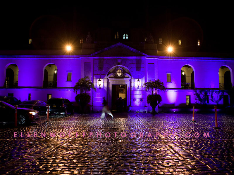 Oheka Castle lit up in purple for a sweet 16, on a rainy night