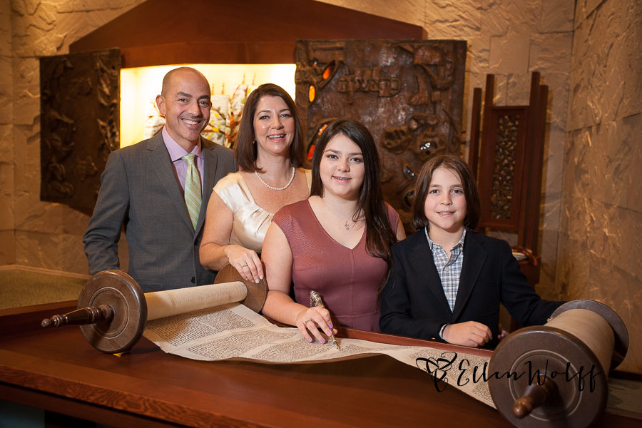 Bat Mitzvah portrait with an open torah scroll